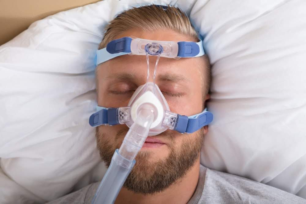 Image showing sleeping man with nasal CPAP machine